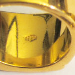 "The ""18 kt"" hallmark on one of the rings"