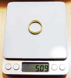 14 kt gold ring on kitchen scale